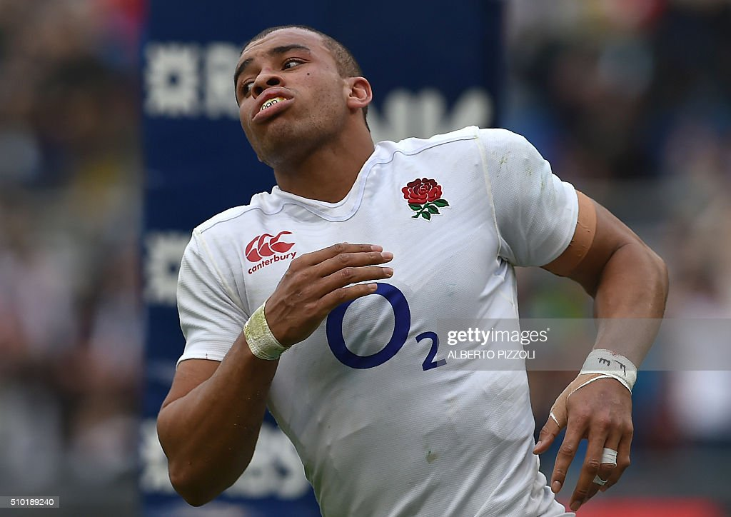 England's centre Jonathan Joseph celebrates after scoring during the Six Nations international rugby union match between Italy and England on February 14, 2016 at the Olympic stadium in Rome. / AFP / ALBERTO PIZZOLI
