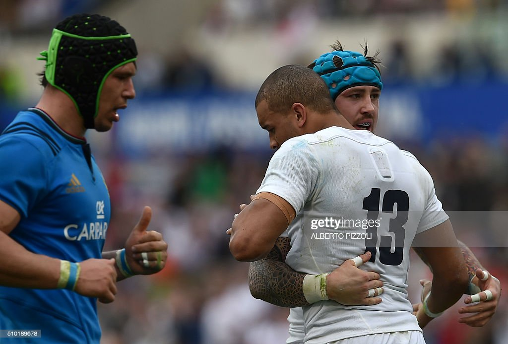 England's centre Jonathan Joseph (Front R) celebrates with teammate wing Jack Nowell after scoring a try during the Six Nations international rugby union match between Italy and England on February 14, 2016 at the Olympic stadium in Rome. / AFP / ALBERTO PIZZOLI