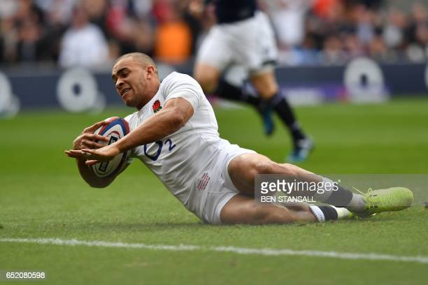 England's centre Jonathan Joseph scores his team's first try during the Six Nations international rugby union match between England and Scotland at...