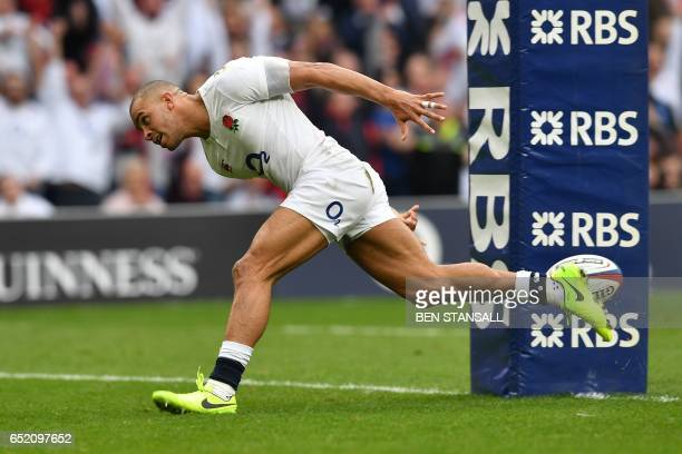 England's centre Jonathan Joseph scores his team's second try during the Six Nations international rugby union match between England and Scotland at...