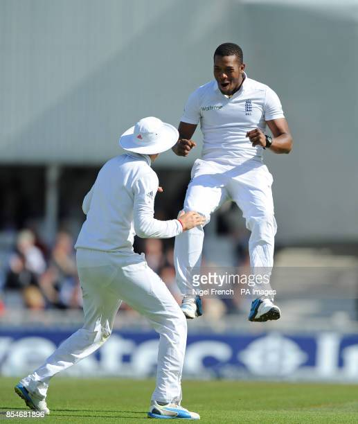 England's Chris Jordan celebrates with Joe Root after taking the wicket of India's Virat Kohli during the Fifth Test at The Kia Oval London