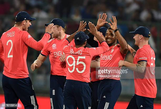 England's Chris Jordan celebrates with teammates after the dismissal of Sri Lanka's Dinesh Chandimal during the World T20 cricket tournament match...