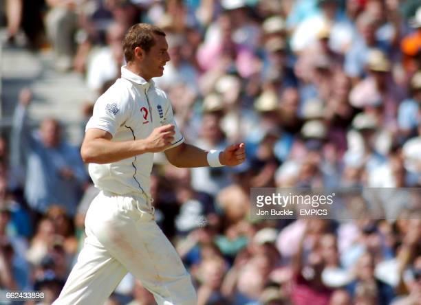 England's Chris Tremlett celebrates claiming the wicket of VVS Laxman of India