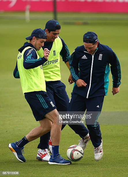 England's Chris Woakes Alistair Cook and Gary Balance battle for the ball during a kick around during the warm up during the England and Pakistan...