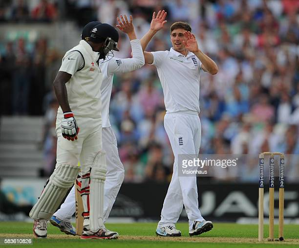 England's Chris Woakes celebrates taking the wicket of Ravichandran Ashwin during Day One of the 5th Investec Test between England and India at the...