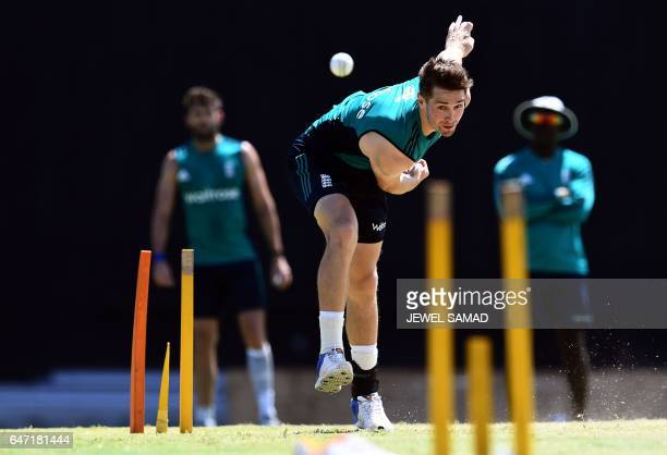 TOPSHOT England's Chris Woakes delivers a ball during a practice session at the Sir Vivian Richards Stadium in St John's Antigua on March 2 2017...