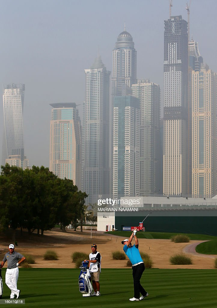 England's Chris Wood (R) hits off the tee box during the first round of the Dubai Desert Classic golf tournament in the Gulf emirate of Dubai on January 31, 2013.