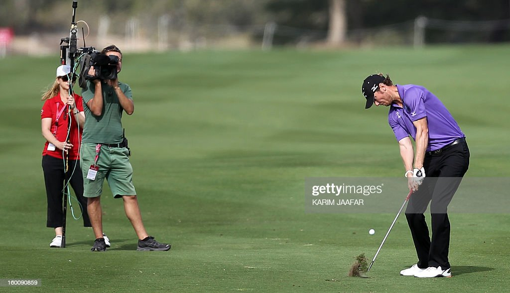 England's Chris Wood plays a shot during the final round of the Qatar Masters Golf Tournament in the capital Doha, on January 26, 2013.