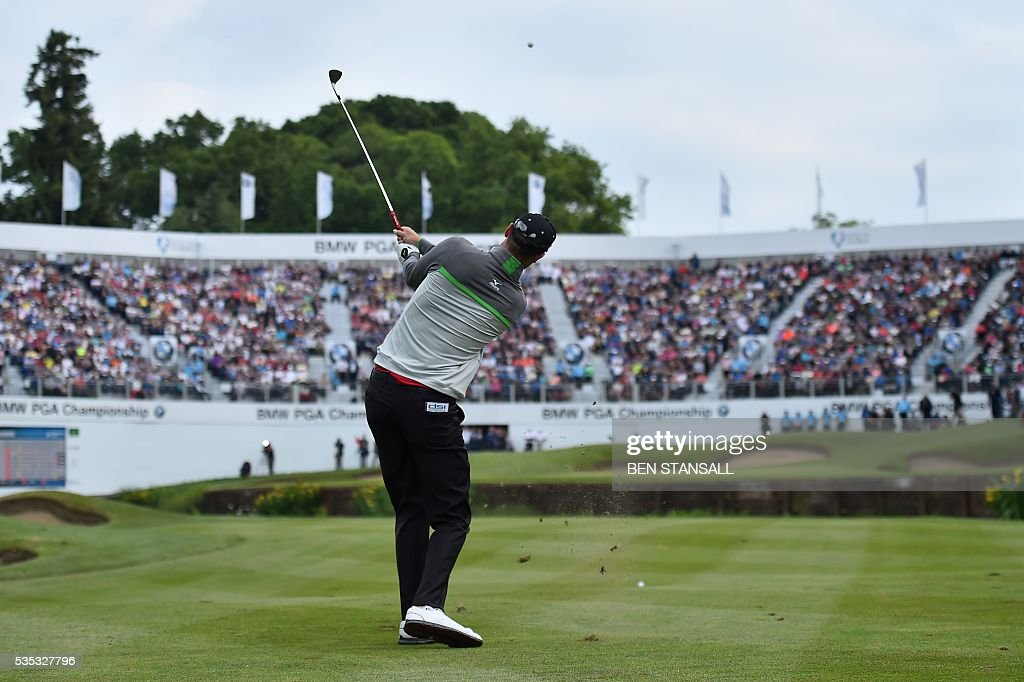 England's Chris Wood plays his third shot on the 18th hole during the fourth day of the golf PGA Championship at Wentworth Golf Club in Surrey, south west of London, on May 29, 2016. / AFP / BEN
