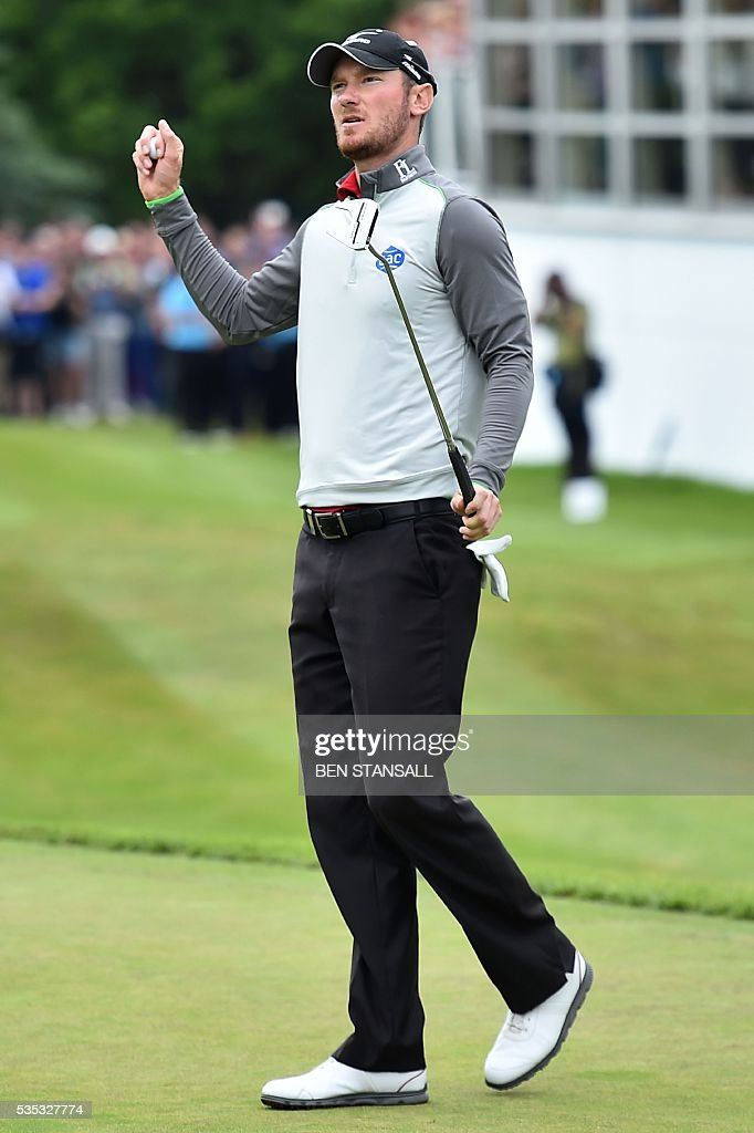 England's Chris Wood reacts after putting on the 18th hole during the fourth day of the golf PGA Championship at Wentworth Golf Club in Surrey, south west of London, on May 29, 2016. / AFP / BEN