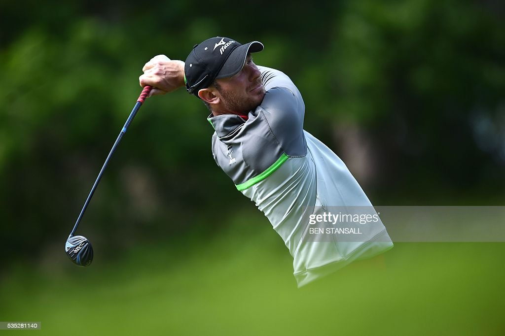 England's Chris Wood watches his tee shot on the 8th hole during the fourth day of the golf PGA Championship at Wentworth Golf Club in Surrey, south west of London, on May 29, 2016. / AFP / BEN
