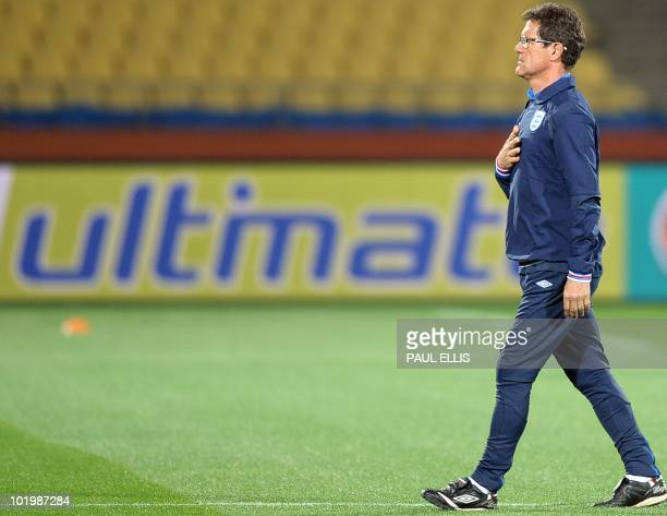 England's coach Fabio Capello arrives for a team training session in Rustenburg on June 11 2010 on the first day of the 2010 World Cup football...