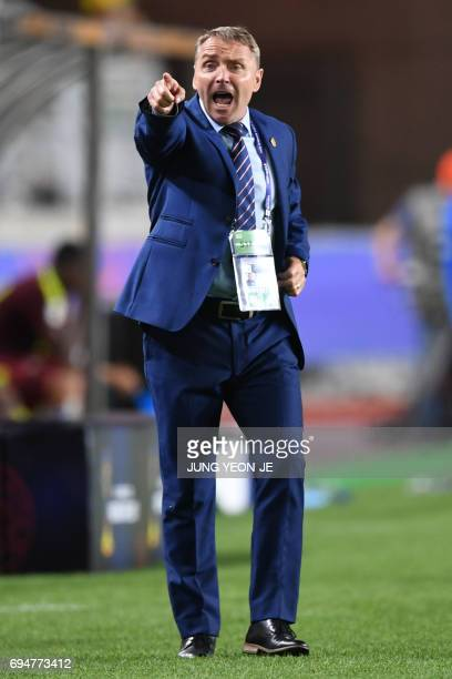 England's coach Paul Simpson reacts during the U20 World Cup final football match between England and Venezuela in Suwon on June 11 2017 / AFP PHOTO...