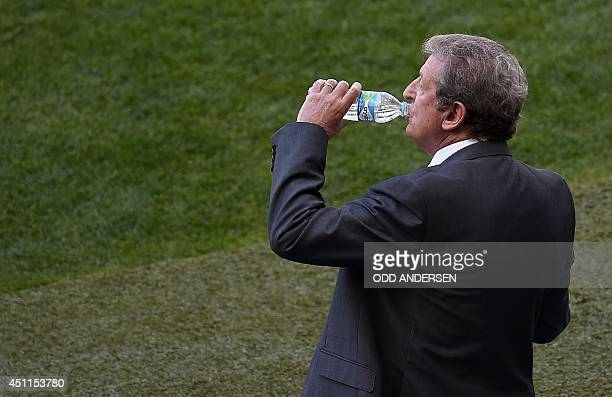 England's coach Roy Hodgson drinks during the Group D football match between Costa Rica and England at The Mineirao Stadium in Belo Horizonte on June...