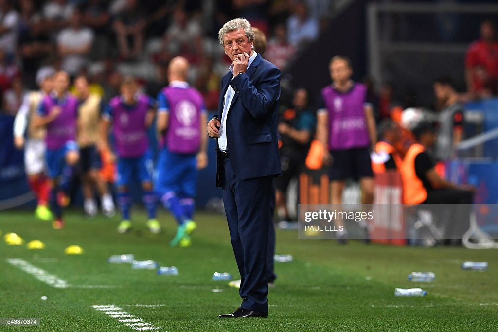 England's coach Roy Hodgson reacts during the Euro 2016 round of 16 football match between England and Iceland at the Allianz Riviera stadium in Nice on June 27, 2016. England lost 2-1 to Iceland. / AFP / PAUL