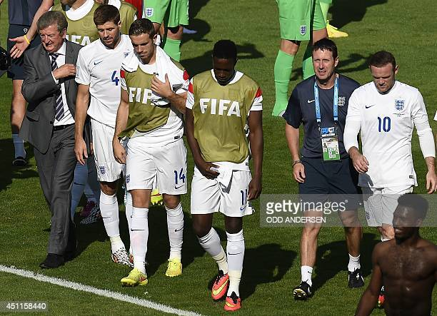 England's coach Roy Hodgson walks with his players after the Group D football match between Costa Rica and England at The Mineirao Stadium in Belo...