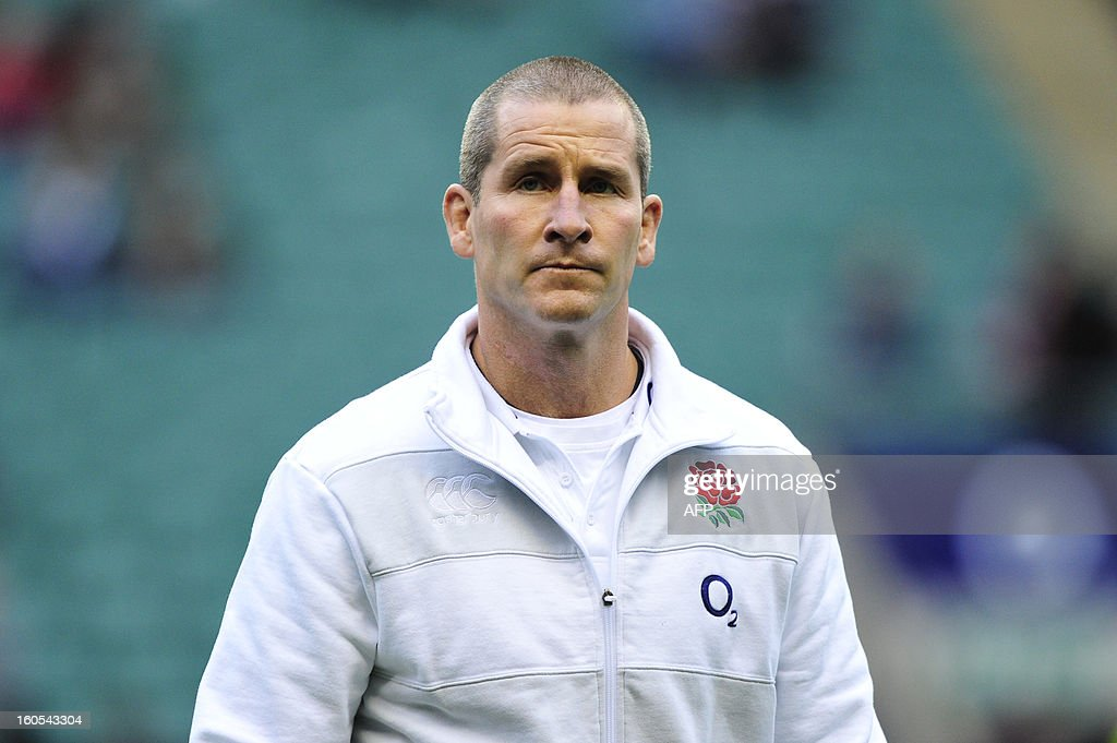 England's coach Stuart Lancaster looks on as his team warms up before the 6 Nations international rugby union match between England and Scotland at Twickenham Stadium, southwest of London on February 2, 2013. England won the game 38 - 18.