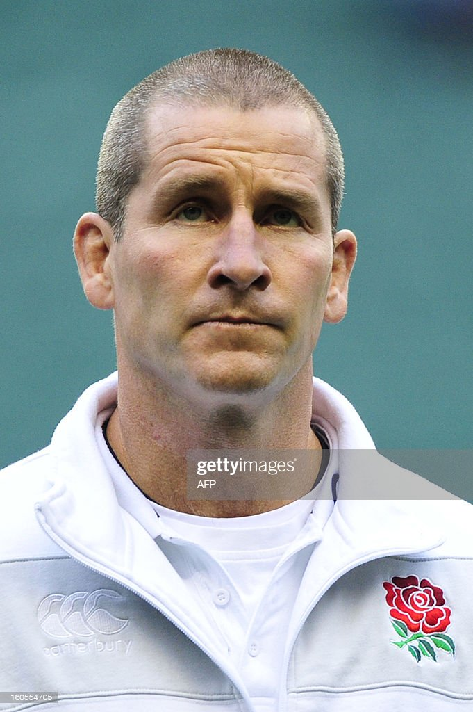 England's coach Stuart Lancaster watches his team warm up before the 6 Nations international rugby union match between England and Scotland at Twickenham Stadium, southwest of London on February 2, 2013. AFP PHOTO / GLYN KIRK