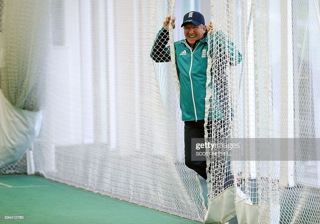 England's coach Trevor Bayliss watches the England squad during an indoor practise session ahead of the second cricket Test match between England and Sri Lanka in Chester-le-Street, north east England on May 26, 2016. England may come into the second Test against Sri Lanka in Durham on the back of a crushing win in the series opener, but according to Stuart Broad the hosts have still to hit top form. England are set to play Sri Lanka in a second test cricket match on May 27. / AFP / SCOTT