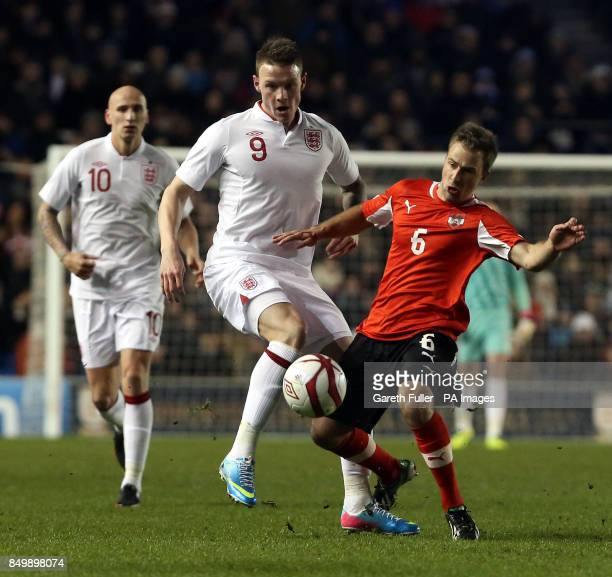 England's Connor Wickham challenges Austria's Tobias Kainz during the U21's International match at the AMEX Stadium Brighton