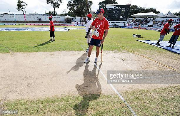 England's cricket team captain Andrew Strauss inspect the pitch as groundsmen work before the start of the third Test match between England and West...