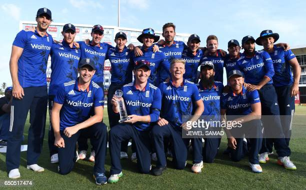 England's cricket team pose with their winning trophy at the end of the final of threematch One Day International series between England and West...