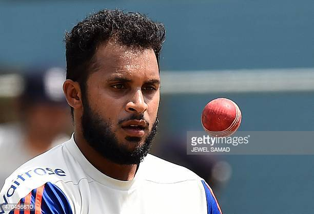 England's cricketer Adil Rashid tosses a ball during a training session at the Grenada National Stadium in Saint George's on April 20 2015 England...