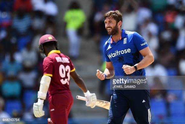 England's cricketer Liam Plunkett celebrates dismissing West Indies batsman Jason Mohammed during the second of the threematch One Day International...