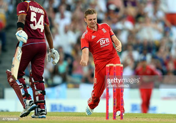 England's cricketer Luke Wright celebrates dismissing West Indies batsman Lendl Simmons during the second T20 match between England and West Indies...