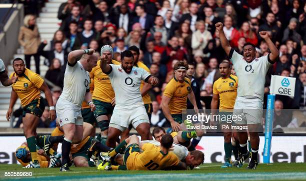 England's Dan Cole Billy Vunipola and Mako Vunipola lead the celebrations as Chris Robshaw scores their first tryduring the QBE International at...
