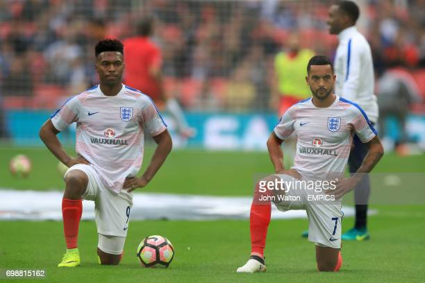 England's Daniel Sturridge and England's Theo Walcott stretch during their warm up