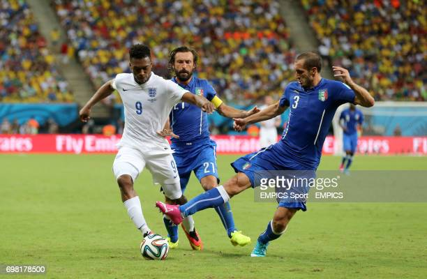 England's Daniel Sturridge and Italy's Giorgio Chiellini battle for the ball during the FIFA World Cup Group D match at the Arena da Amazonia Manaus...