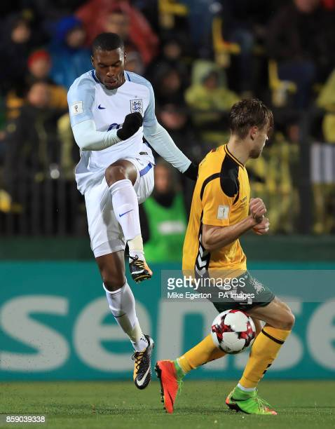 England's Daniel Sturridge and Lithuania's Arturas Zulpa battle for the ball during the 2018 FIFA World Cup Qualifying Group F match at the LFF...