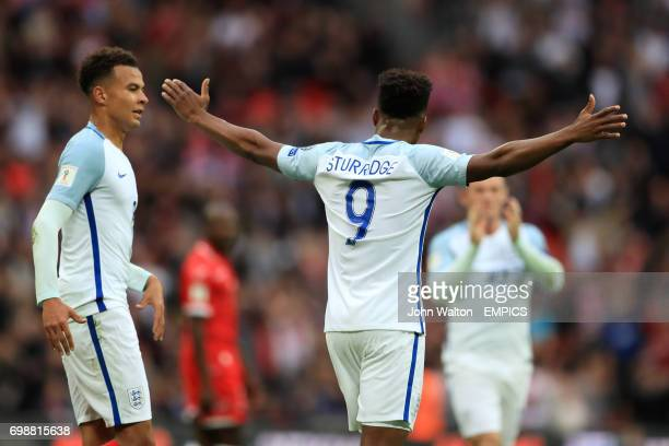 England's Daniel Sturridge celebrates scoring his side's first goal of the game