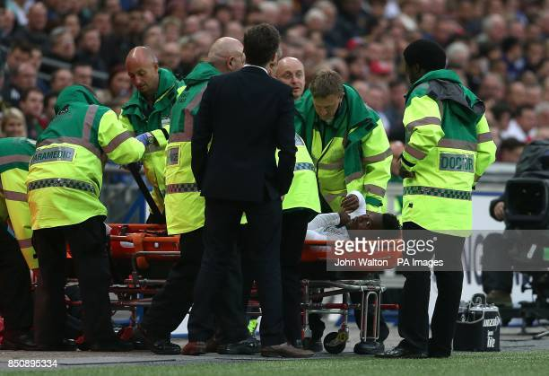 England's Daniel Sturridge leaves the pitch on a stretcher after picking up an injury