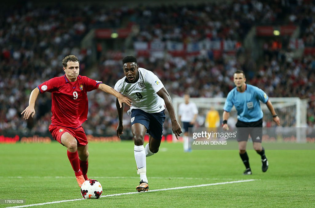 England's Daniel Welbeck (C) vies for the ball against Moldova's Alexsandru Antoniuc (L) during the World Cup 2014 Group H qualifying football match between England and Moldova at Wembley Stadium in north London, on September 6, 2013.