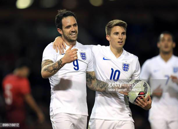 England's Danny Ings celebrates scoring the third goal with teammate Tom Carroll