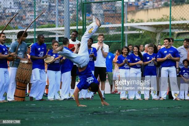 England's Danny Welbeck and Adam Lallana during a visit to the Complexo Esportivo da Rocinha Rio de Janeiro Brazil