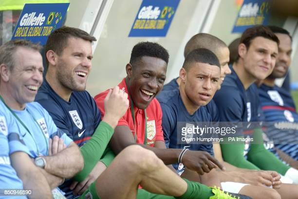 England's Danny Welbeck and Alex OxladeChamberlain enjoy a laugh on the substitute's bench before the game