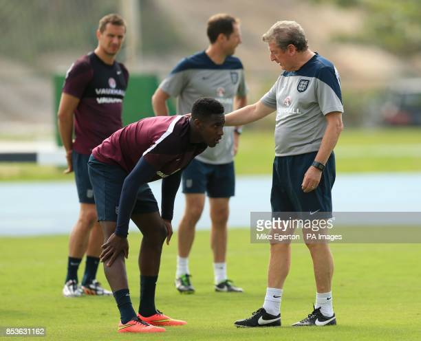 England's Danny Welbeck and manager Roy Hodgson during a training session at Urca Military Training Ground Rio de Janeiro Brazil