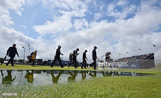 England's Danny Willett and group walk down the 2nd fairway during his second round on day two of the 2015 British Open Golf Championship on The Old...
