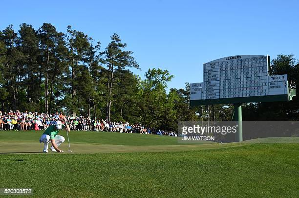 England's Danny Willett lines up a putt on the 18th green during Round 4 of the 80th Masters Golf Tournament at the Augusta National Golf Club on...