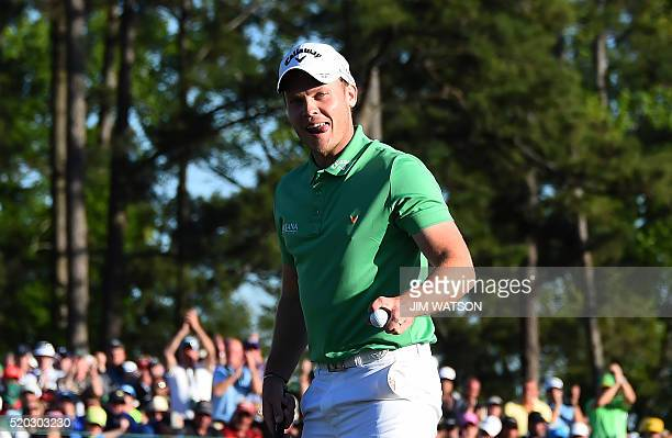 England's Danny Willett reacts after putting on the 18th green during Round 4 of the 80th Masters Golf Tournament at the Augusta National Golf Club...