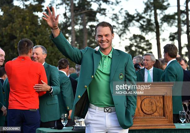 England's Danny Willett waves after receiving his Green Jacket at the end of the 80th Masters Golf Tournament at the Augusta National Golf Club on...