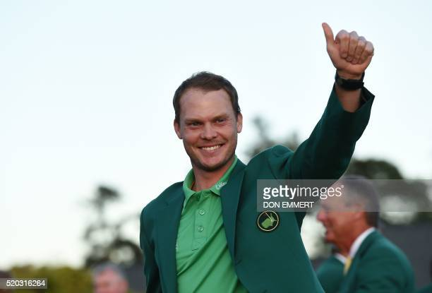 TOPSHOT England's Danny Willett waves wearing his Green Jacket at the end of the 80th Masters Golf Tournament at the Augusta National Golf Club on...