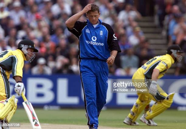 England's Darren Gough scratches his head as Australian batting pair Adam Gilchrist and Ricky Ponting turn for a second run during NatWest Series...