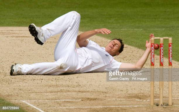 England's Darren Pattinson lies on the pitch after failing to catch out South Africa's Mark Boucher off his own bowling during the Second npower Test...
