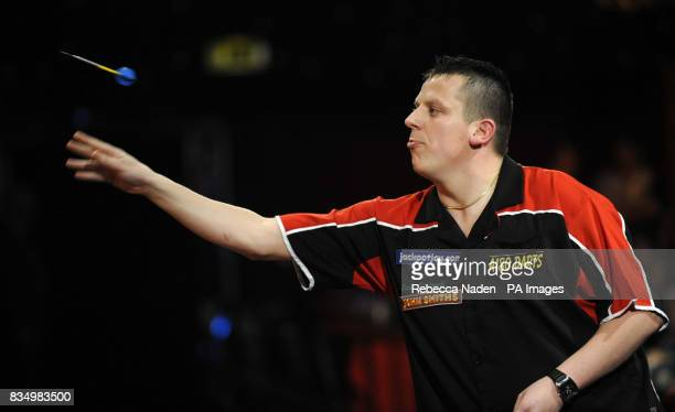 England's Dave Chisnall in action against Martin Adams during the World Darts Championship at Frimley Green Surrey