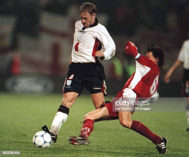 FEATURE England's David Batty challenges Luxembourg's Jeff Saibene for the ball at tonight's Euro 2000 qualification match at Luxembourg's Josy...