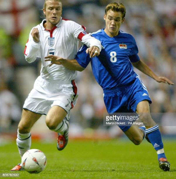 England's David Beckham challenges Andreas Gerster of Liechtenstein for the ball during their group seven Euro 2004 qualifier at Old Trafford...